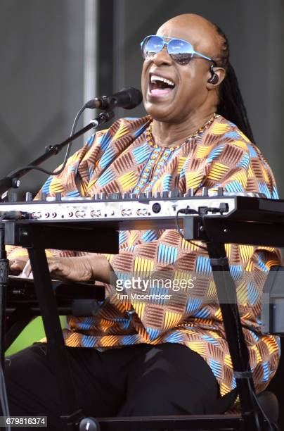 Stevie Wonder performs during the 2017 New Orleans Jazz Heritage Festival at Fair Grounds Race Course on May 6 2017 in New Orleans Louisiana