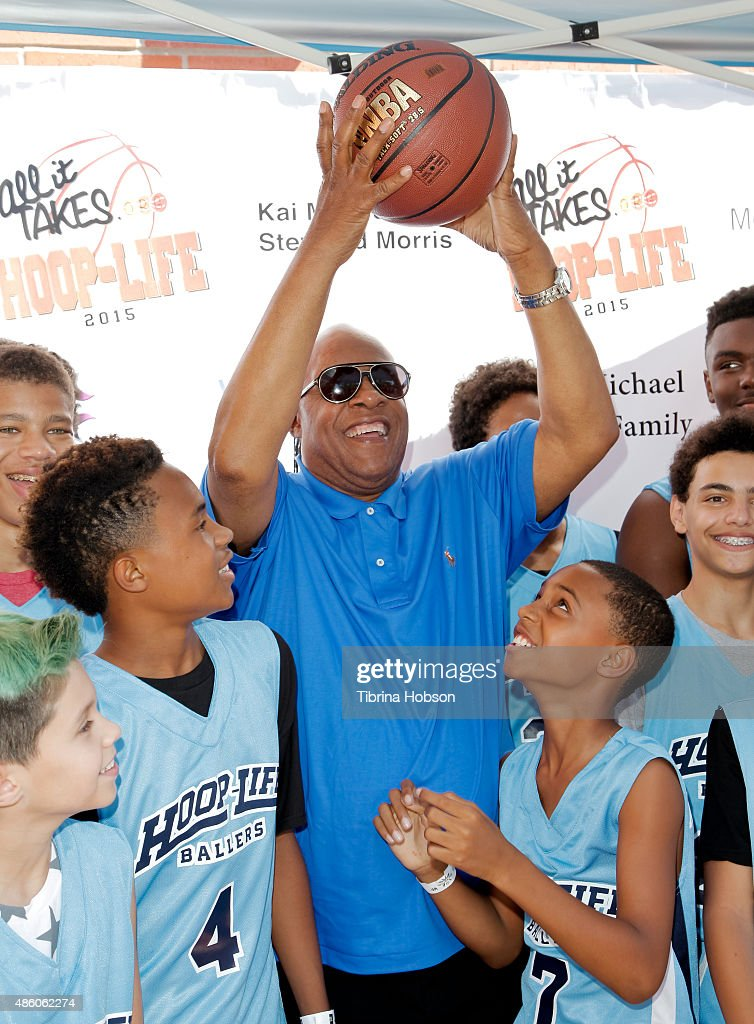 Stevie Wonder (C) plays around with his sons Kailand Morris (L) and Mandla Morris (R) at the 3rd annual Hoop-Life FriendRaiser at Galen Center on August 30, 2015 in Los Angeles, California.