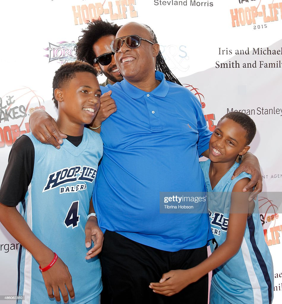 Stevie Wonder (C) plays around with his sons Kailand Morris, Kwame Morris and Mandla Morris at the 3rd annual Hoop-Life FriendRaiser at Galen Center on August 30, 2015 in Los Angeles, California.