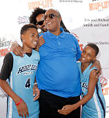 Stevie Wonder plays around with his sons Kailand Morris Kwame Morris and Mandla Morris at the 3rd annual HoopLife FriendRaiser at Galen Center on...