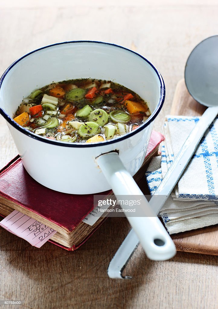 stew vegetables in pan on kitchen table : Stock Photo