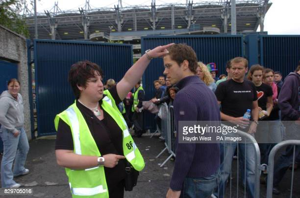 A steward directs U2 fans to the queuing areas for people with tickets for the pitch at the St James Avenue entrance Diehard fans have been queuing...