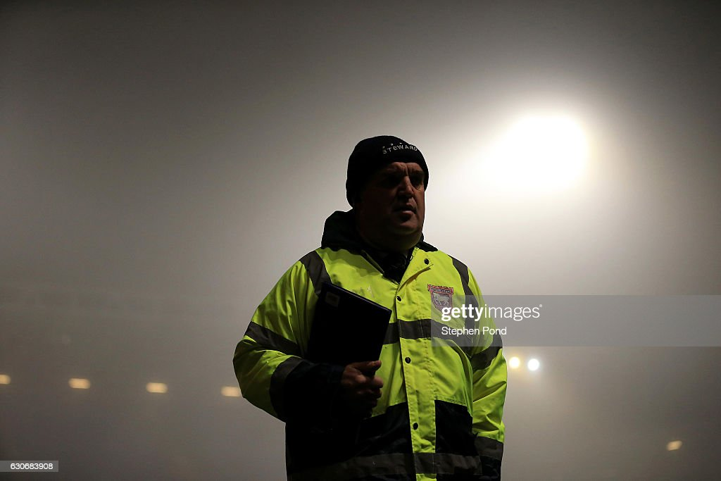 A steward is seen as fog surrounds the stadium ahead of the Sky Bet Championship match between Ipswich Town and Bristol City at Portman Road on December 30, 2016 in Ipswich, England.