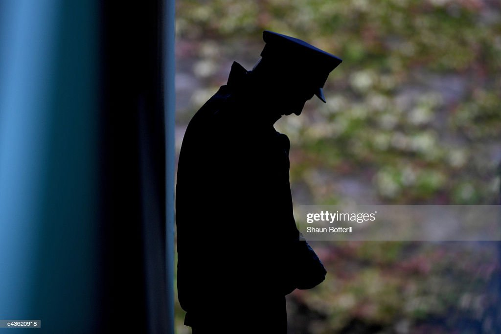 A steward looks on during day three of the Wimbledon Lawn Tennis Championships at the All England Lawn Tennis and Croquet Club on June 29, 2016 in London, England.