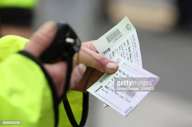 A Steward scans a fans tickets prior to entry