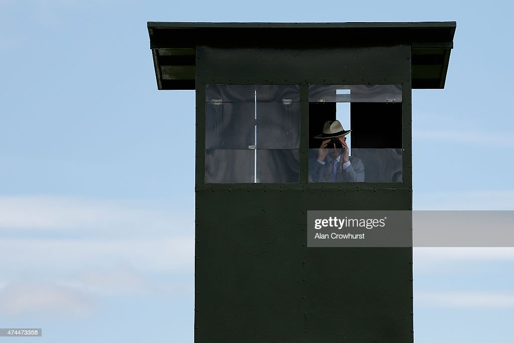A steward watches the action from his vantage point at Curragh racecourse on May 23 2015 in Kildare Ireland