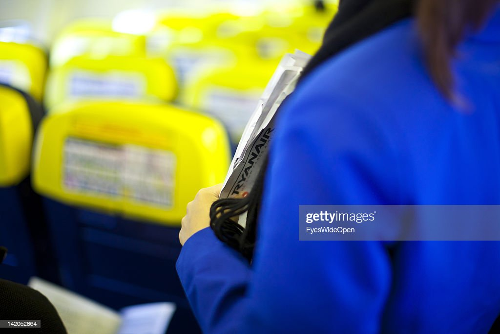 Stewardess at boarding for departure of a RyanAir flight to Alicante, Spain at Allgaeu Airport on February 18, 2012 in Memmingen, Germany.