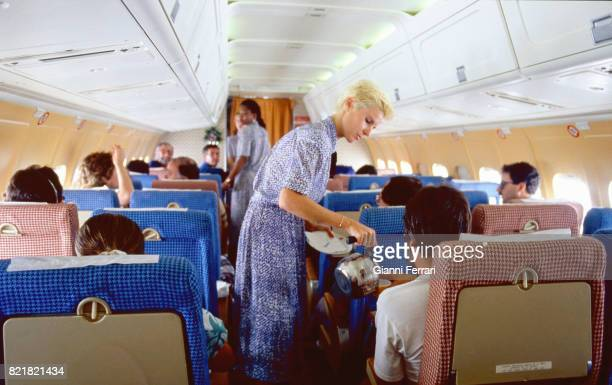 Stewardess attending to a traveler travel from Madrid to Barcelona Spain