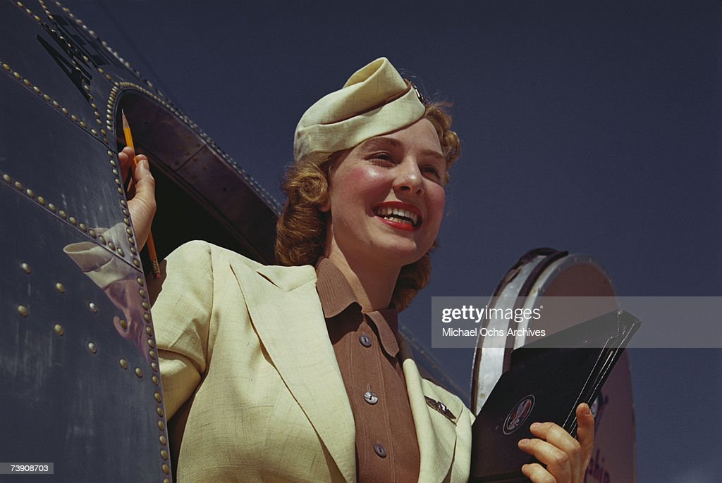 A Stewardess exits the plane exits an American Airlines Douglas DC-3 at La Guardia Airport in June 1950 in New York City, New York.