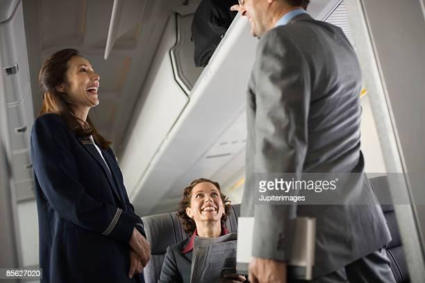 Stewardess greeting passengers