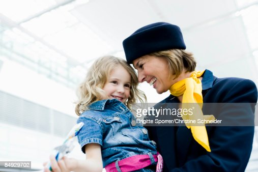 Stewardess holding child in her arms