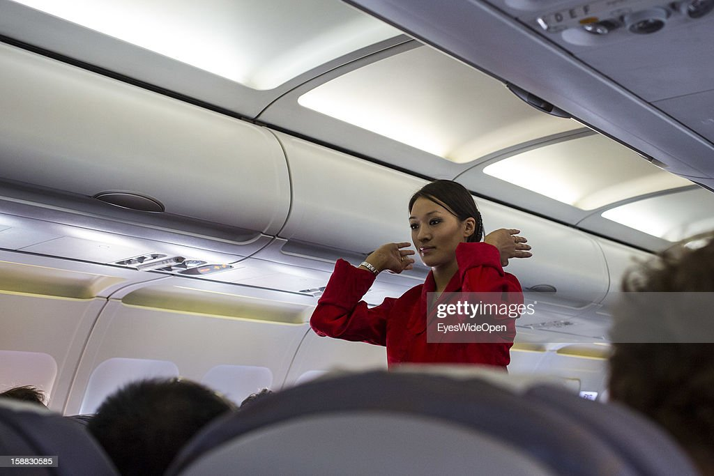 A stewardess in an aeroplane of the Royal Bhutan Airline Drukair on arrival at Paro Airport , one of the most dangerous airports in the world on November 18, 2012 in Paro near Thimphu, Bhutan. Only eight pilots are said to be able to land there.