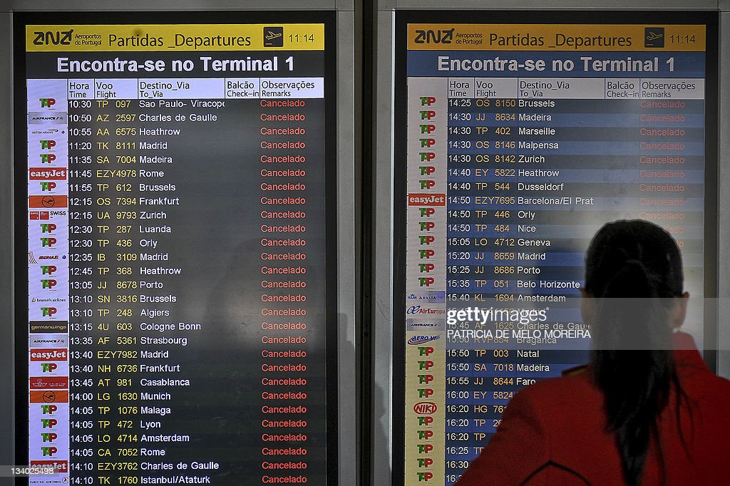 A stewardess looks on November 24, 2011 at the departures panel, showing all flights cancelled, at Lisbon international airport during a general strike. A general strike against austerity measures grounded flights and paralyzed public transport in Portugal on November 24 as workers protested a tough 2012 budget aimed at helping the country pay its debt. Authorities cancelled nearly all flights in and out of the nation's main airports, the Lisbon metro came to a standstill and ferries across the capital's Tagus River functioned only intermittently in what unions said was a necessary bitter pill.