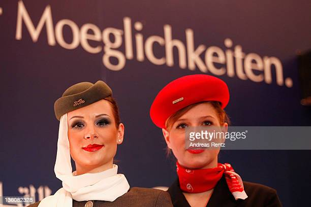 A stewardess of Etihad Airways and a stewardess of German airline Airberlin look on during a press conference on December 19 2011 in Berlin Germany...