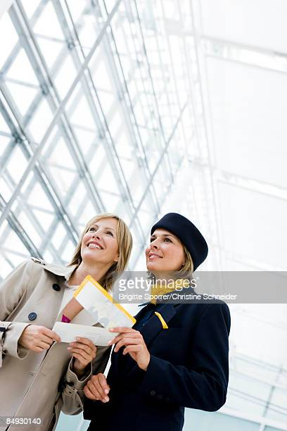 Stewardess showing woman directions