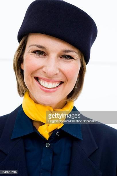 Stewardess smiling at viewer