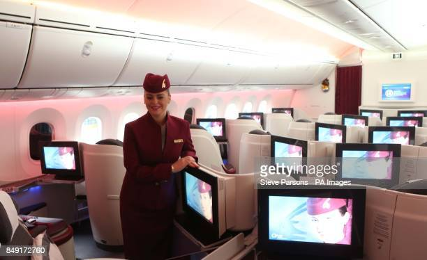 A stewardess stands in Business Class of Qatar Airways' new 787 Dreamliner after it arrived on its debut flight into Heathrow Airport