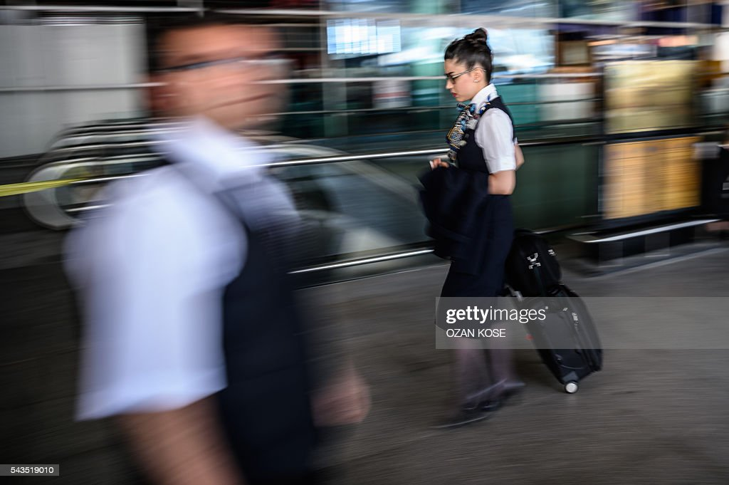 A stewardess walks on June 29, 2016 outside the arrivals terminal of Ataturk International airport in Istanbul, a day after a suicide bombing and gun attack targeted Istanbul's airport, killing at least 36 people. A triple suicide bombing and gun attack that occurred on June 28, 2016 at Istanbul's Ataturk airport has killed at least 36 people, including foreigners, with Turkey's prime minister saying early signs pointed to an assault by the Islamic State group. / AFP / OZAN