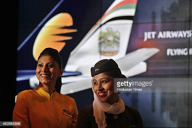 Stewardesses from Jet Airways and Etihad Airways during a joint press conference on July 23 2014 in New Delhi India Abu Dhabis Etihad Airways became...