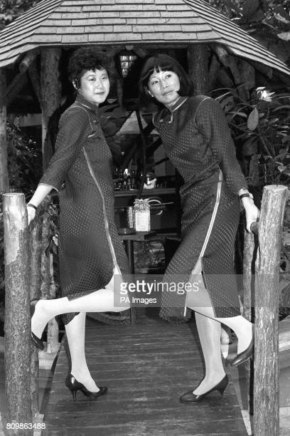 Stewardesses Mary Miao and Theresa Archer celebrate the Chinese New Year the year of the Rabbit by modelling at an Hotel near Heathrow Airport the...