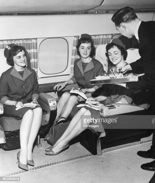 Stewardesses of Canadian Pacific Airlines who after cabin training are served a traditional graduation tea by their boss instructor Fred Woodman The...