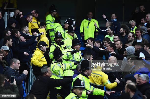 Stewards and police restrain fans after the Barclays Premier League match between Manchester City and Manchester United at Etihad Stadium on March 20...