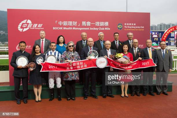 Stewards Chief Executive Officer and presenting guests for the BOCHK Wealth Management Jockey Club Mile pose for a group photo with the winning...
