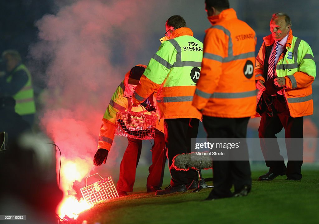 Stewards extinguish a flare during the Sky Bet Championship match between Birmingham City and Middlesbrough at St Andrews on April 29, 2016 in Birmingham, United Kingdom.