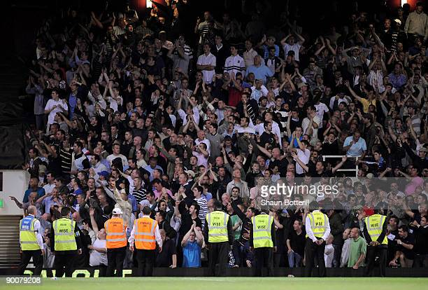 Stewards stand infront of the Millwall fans during the Carling Cup second round match between West Ham United and Millwall at Upton Park on August 25...