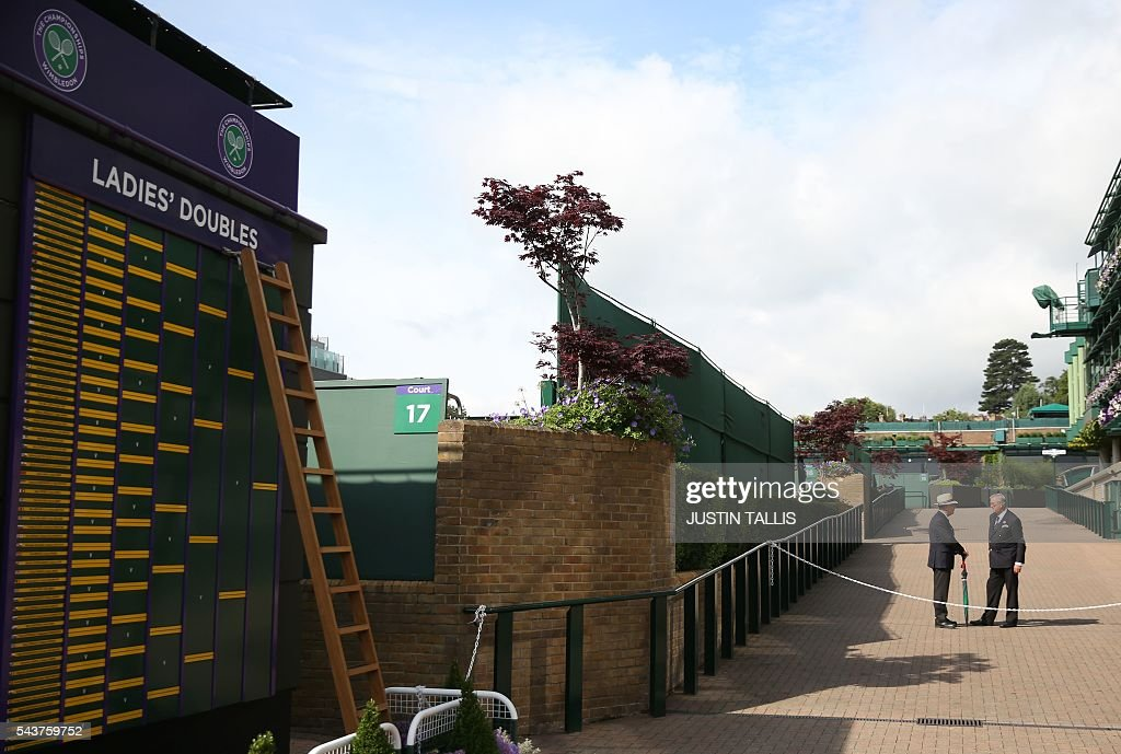 Stewards wait for the start of play on the fourth day of the 2016 Wimbledon Championships at The All England Lawn Tennis Club in Wimbledon, southwest London, on June 30, 2016. / AFP / JUSTIN