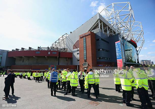 Stewards wait outside the ground after the game was abandoned with fans evacuated from the ground prior to the Barclays Premier League match between...