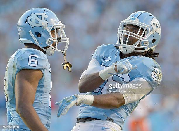 J Stewart and Dominquie Green of the North Carolina Tar Heels reacts after a defensive stop against the Miami Hurricanes during their game at Kenan...