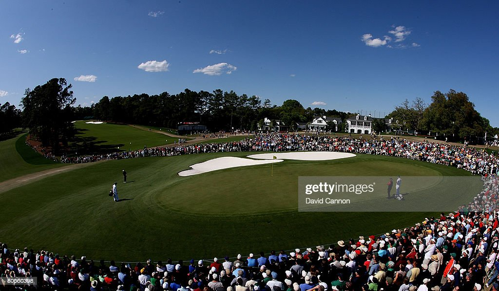 Stewart Cink and Tiger Woods play the ninth hole during the final round of the 2008 Masters Tournament at Augusta National Golf Club on April 13 2008...