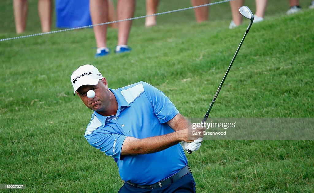 Stewart Cink of the United States plays a bunker shot on the ninth hole during the second round of THE PLAYERS Championship on The Stadium Course at TPC Sawgrass on May 9, 2014 in Ponte Vedra Beach, Florida.