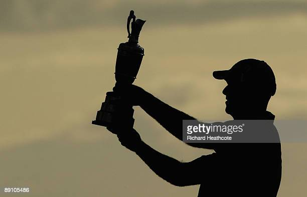 Stewart Cink of USA holds the Claret Jug aloft after his victory in a play off against Tom Watson of USA following the final round of the 138th Open...