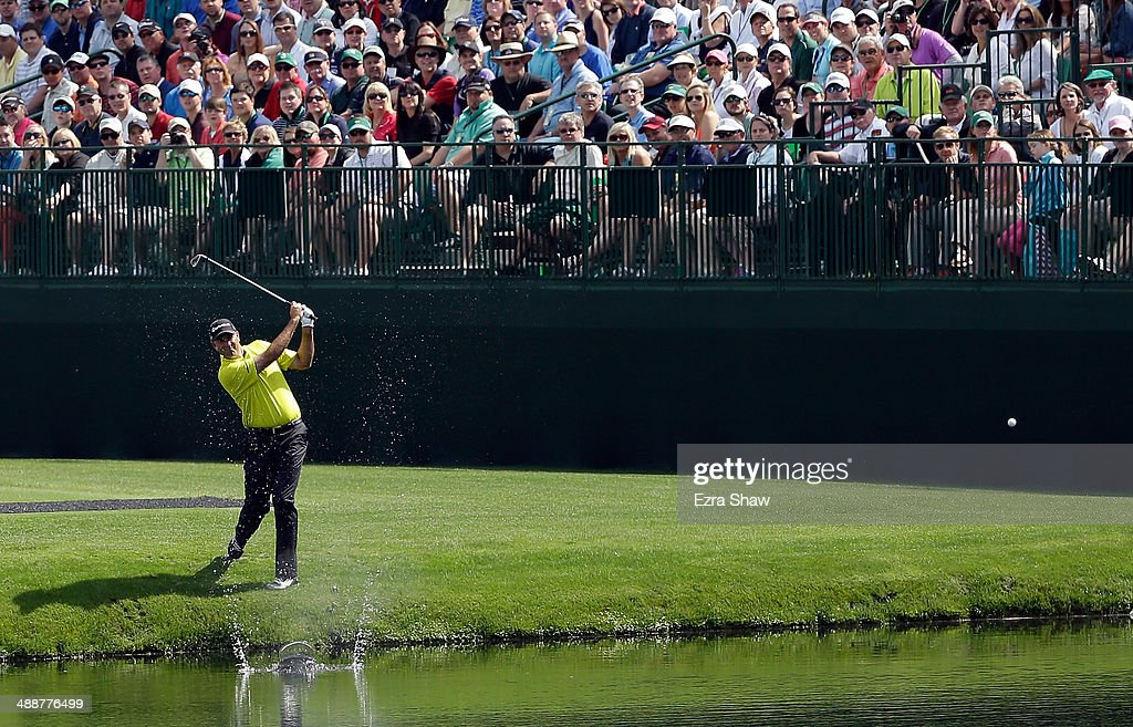 <a gi-track='captionPersonalityLinkClicked' href=/galleries/search?phrase=Stewart+Cink&family=editorial&specificpeople=239533 ng-click='$event.stopPropagation()'>Stewart Cink</a> skips the ball across the pond on the 16th hole during a practice round at Augusta National Golf Club on April 8, 2014 in Augusta, Georgia.