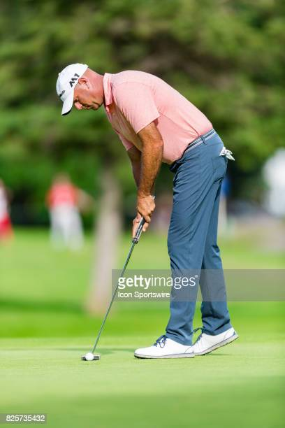 Stewart Cink taps in a short putt on the green of the 9th hole during second round action of the RBC Canadian Open on July 28 at Glen Abbey Golf Club...