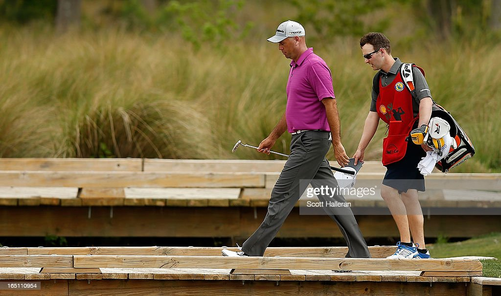 Stewart Cink walks with his caddie on the 17th hole during the third round of the Shell Houston Open at the Redstone Golf Club on March 30, 2013 in Humble, Texas.