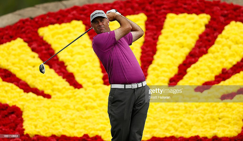 Stewart Cink watches his tee shot on the 18th hole during the third round of the Shell Houston Open at the Redstone Golf Club on March 30 2013 in...