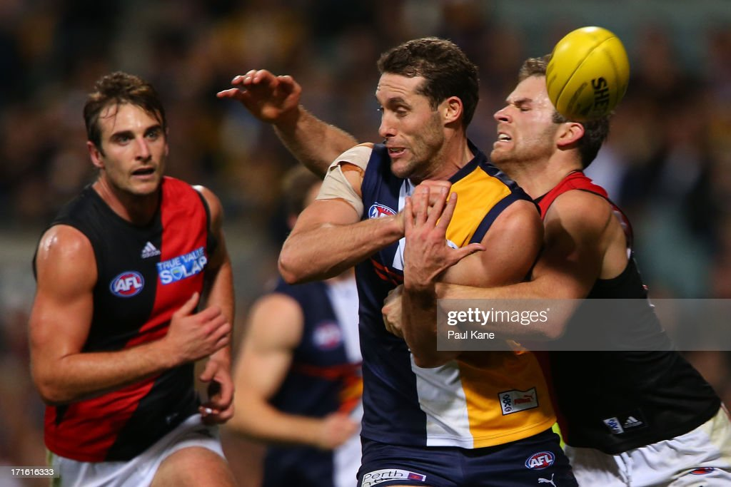 Stewart Crameri of the Bombers tackles <a gi-track='captionPersonalityLinkClicked' href=/galleries/search?phrase=Darren+Glass&family=editorial&specificpeople=235915 ng-click='$event.stopPropagation()'>Darren Glass</a> of the Eagles during the round 14 AFL match between the West Coast Eagles and the Essendon Bombers at Patersons Stadium on June 27, 2013 in Perth, Australia.