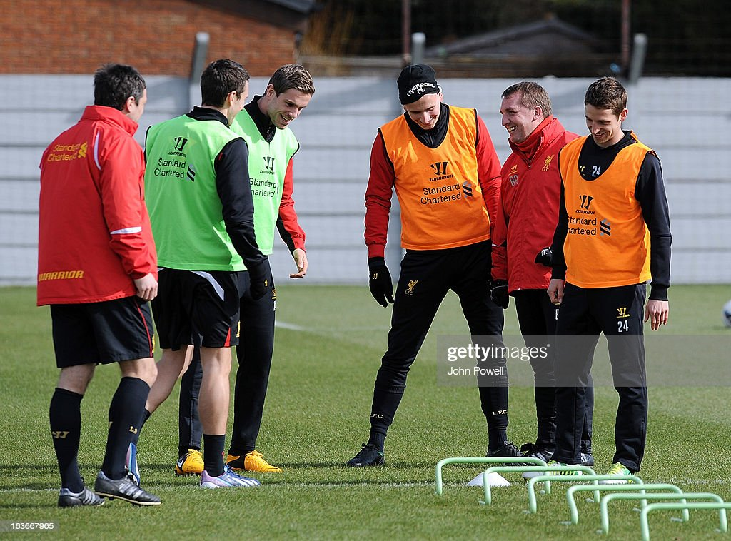 Stewart Downing, Jordan Henderson, Jonjo Shelvey and Joe Allen of Liverpool talk with Brendan Rodgers manager of Liverpool during a training session at Melwood Training Ground on March 14, 2013 in Liverpool, England.