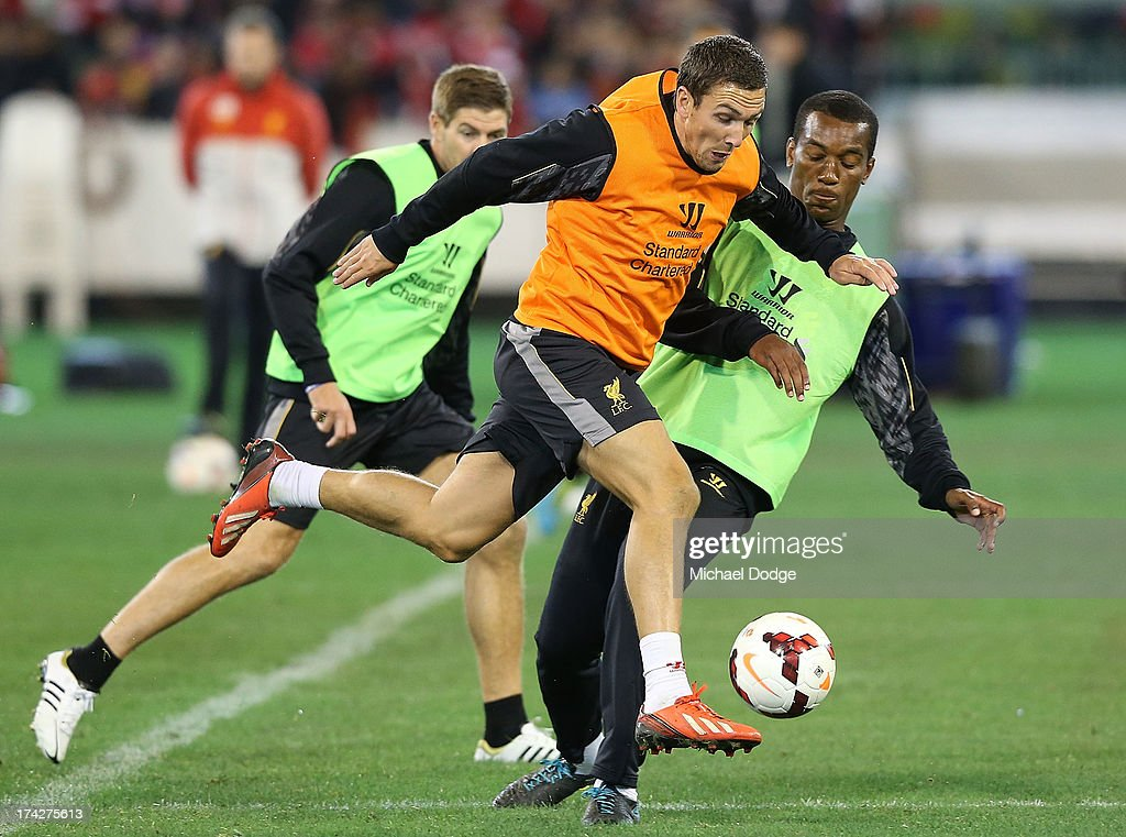 <a gi-track='captionPersonalityLinkClicked' href=/galleries/search?phrase=Stewart+Downing&family=editorial&specificpeople=238961 ng-click='$event.stopPropagation()'>Stewart Downing</a> kicks the ball past Andre Wisdom during a Liverpool FC training session at Melbourne Cricket Ground on July 23, 2013 in Melbourne, Australia.