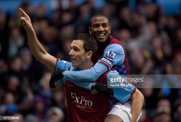 Stewart Downing of Aston Villa celebrates with teammate Ashley Young after scoring during the Barclays Premier League match between Aston Villa and...