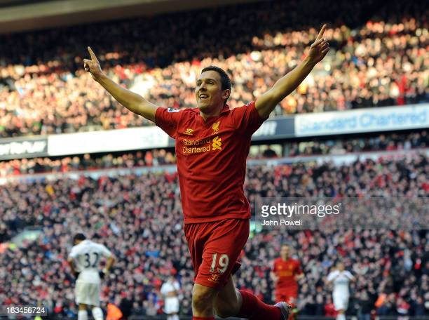 Stewart Downing of Liverpool celebrates his goal during the Barclays Premier League match between Liverpool and Tottenham Hotspur at Anfield on March...