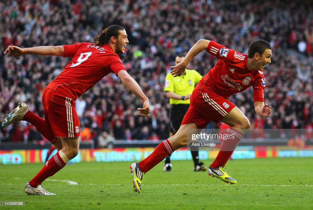 Stewart Downing (R) of Liverpool celebrates his goal with Andy Carroll during the FA Cup with Budweiser Sixth Round match between Liverpool and Stoke City at Anfield on March 18, 2012 in Liverpool, England.
