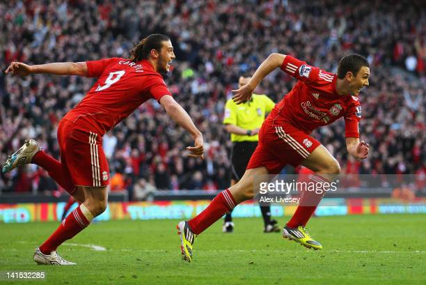 Stewart Downing of Liverpool celebrates his goal with Andy Carroll during the FA Cup with Budweiser Sixth Round match between Liverpool and Stoke...