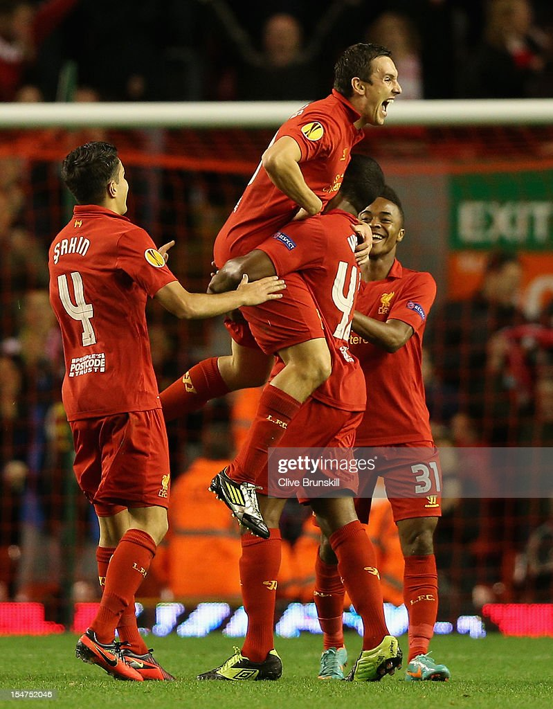 Stewart Downing of Liverpool celebrates scoring the opening goal during the UEFA Europa League Group A match between Liverpool FC and FC Anzhi Makhachkala at Anfield on October 25, 2012 in Liverpool, England.
