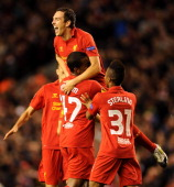 Stewart Downing of Liverpool celebrates with teammates after scoring the winning goal during the UEFA Europa League group stage match between...