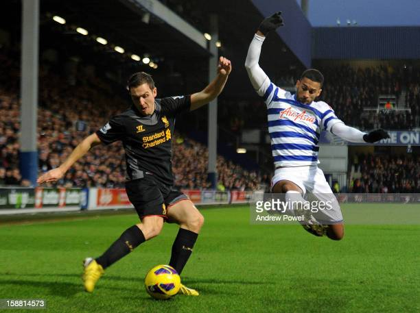 Stewart Downing of Liverpool competes with Armand Traore of Queens Park Rangers during the Barclays Premier League match between Queens Park Rangers...