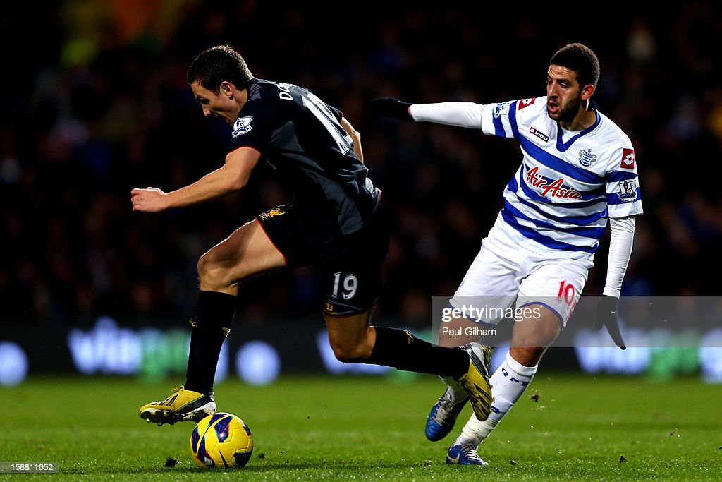 Stewart Downing of Liverpool goes past the challenge from Adel Taarabt of QPR during the Barclays Premier League match between Queens Park Rangers and Liverpool at Loftus Road on December 30, 2012 in London, England.